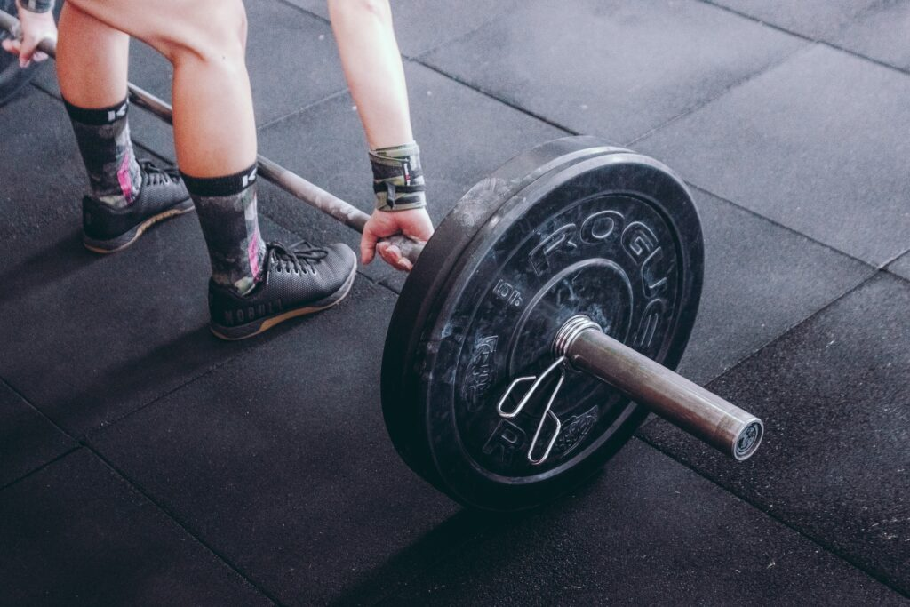 woman preparing to lift barbell