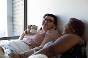 two-women-arguing-healthfully-in-bed