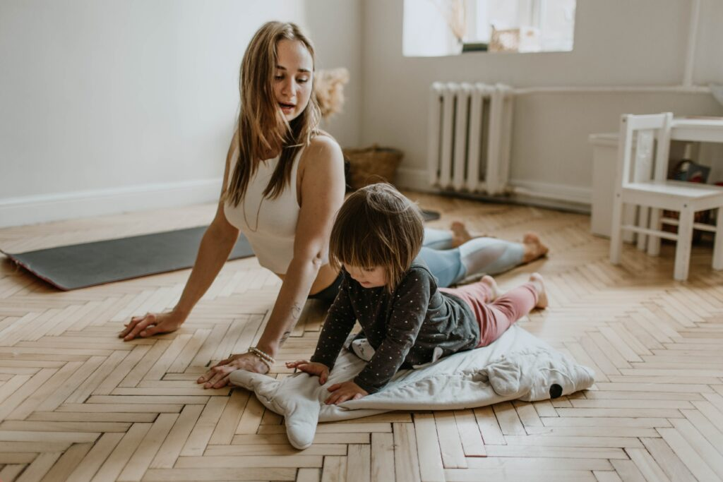 Woman doing yoga with child not morning person